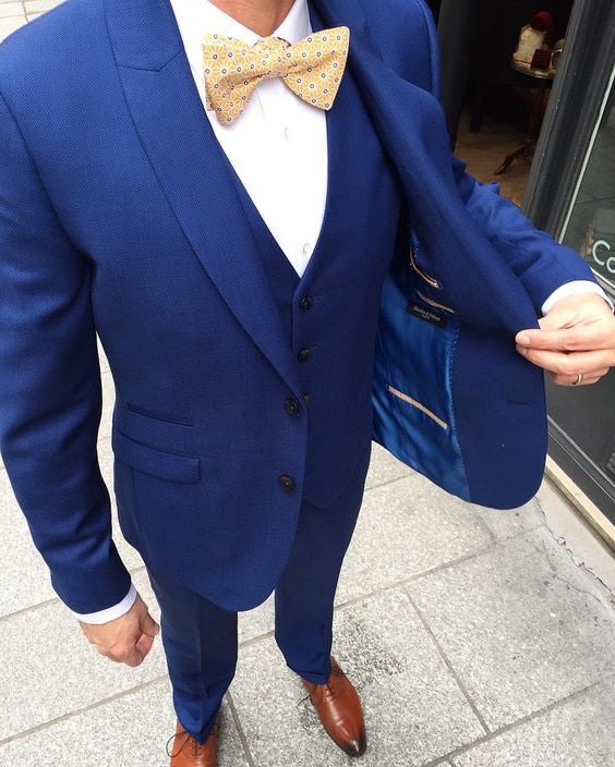 Blue Suit and Gold Bow Tie