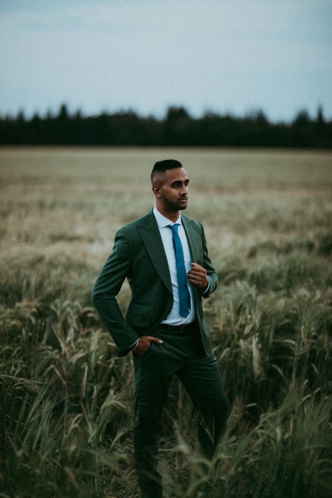 Green suit and blue tie combo