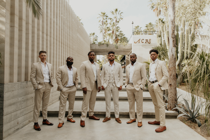 Groomsmen wearing tan suits